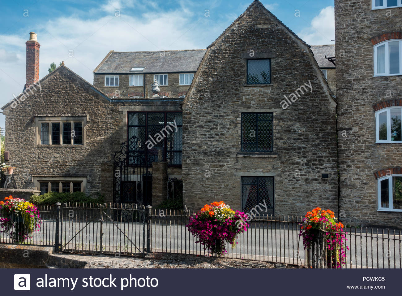 Part of the old Malmesbury Silk Mills, now converted into accommodation, Malmesbury, Wiltshire - Stock Image