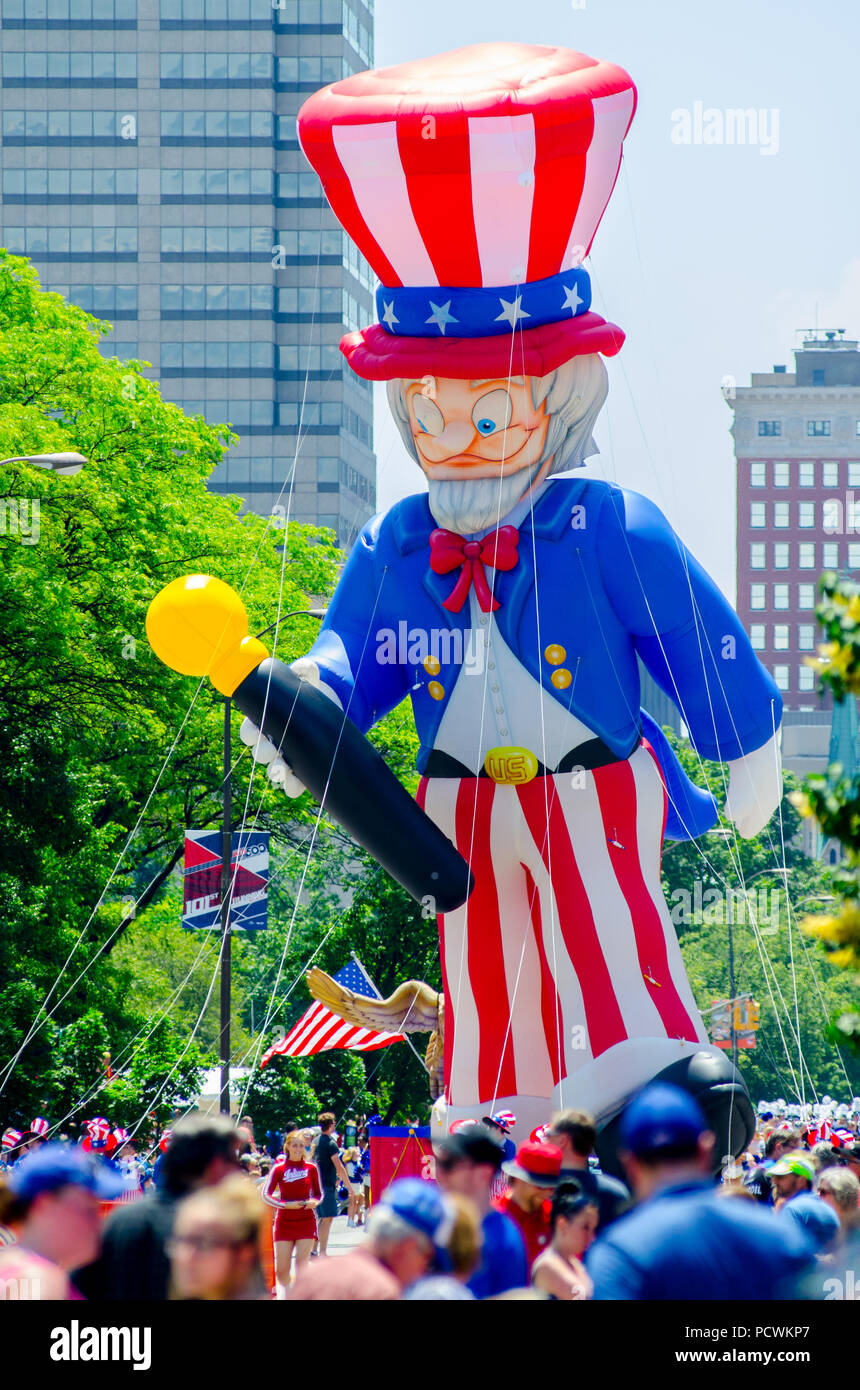 INDIANAPOLIS, IN - May 27, 2017: A giant inflatable Uncle Sam tethered by ropes floats his way down North Meridian Street during the annual Indianapolis 500 Festival parade Memorial Day weekend. - Stock Image