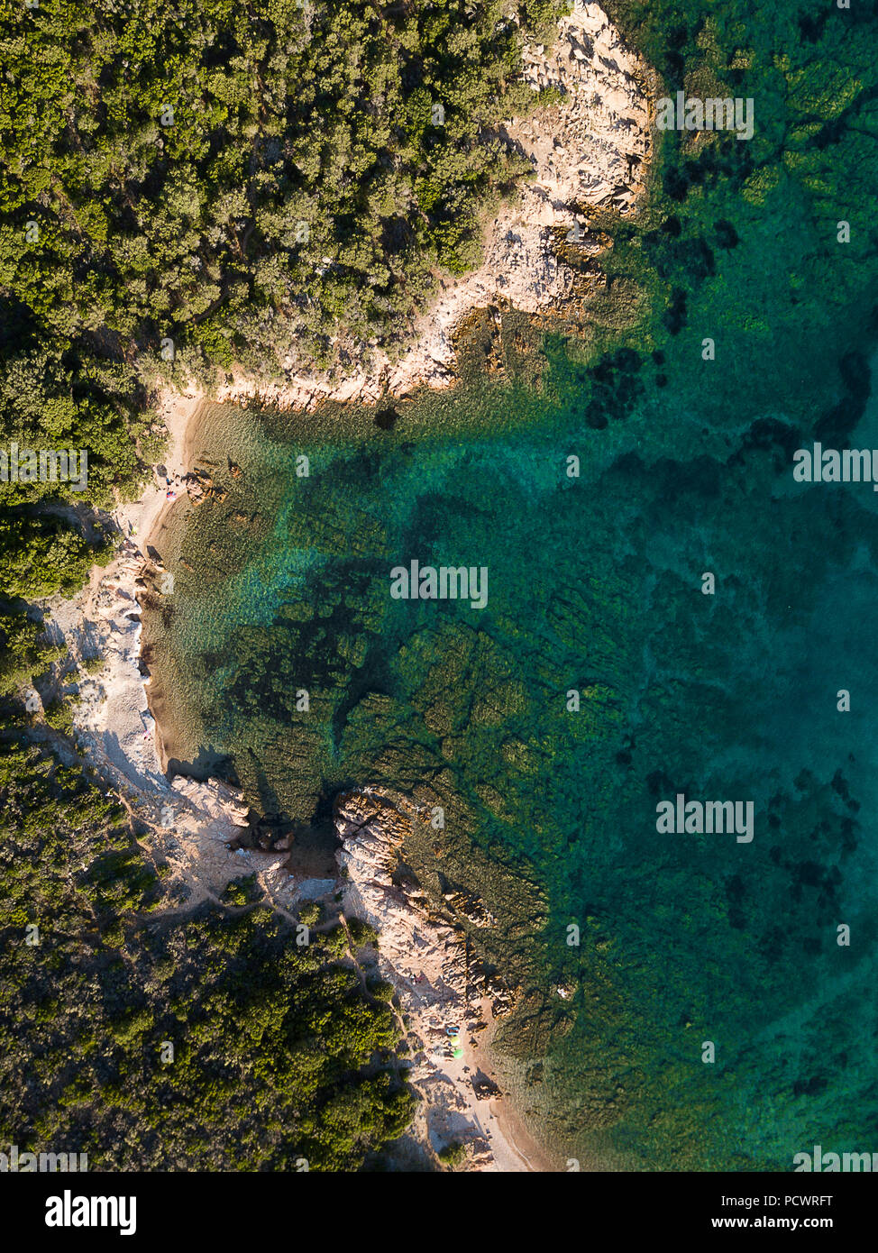 View from above, aerial view of a rocky coast bathed by an emerald and transparent Mediterranean sea, Costa Smeralda, Sardinia, Italy - Stock Image