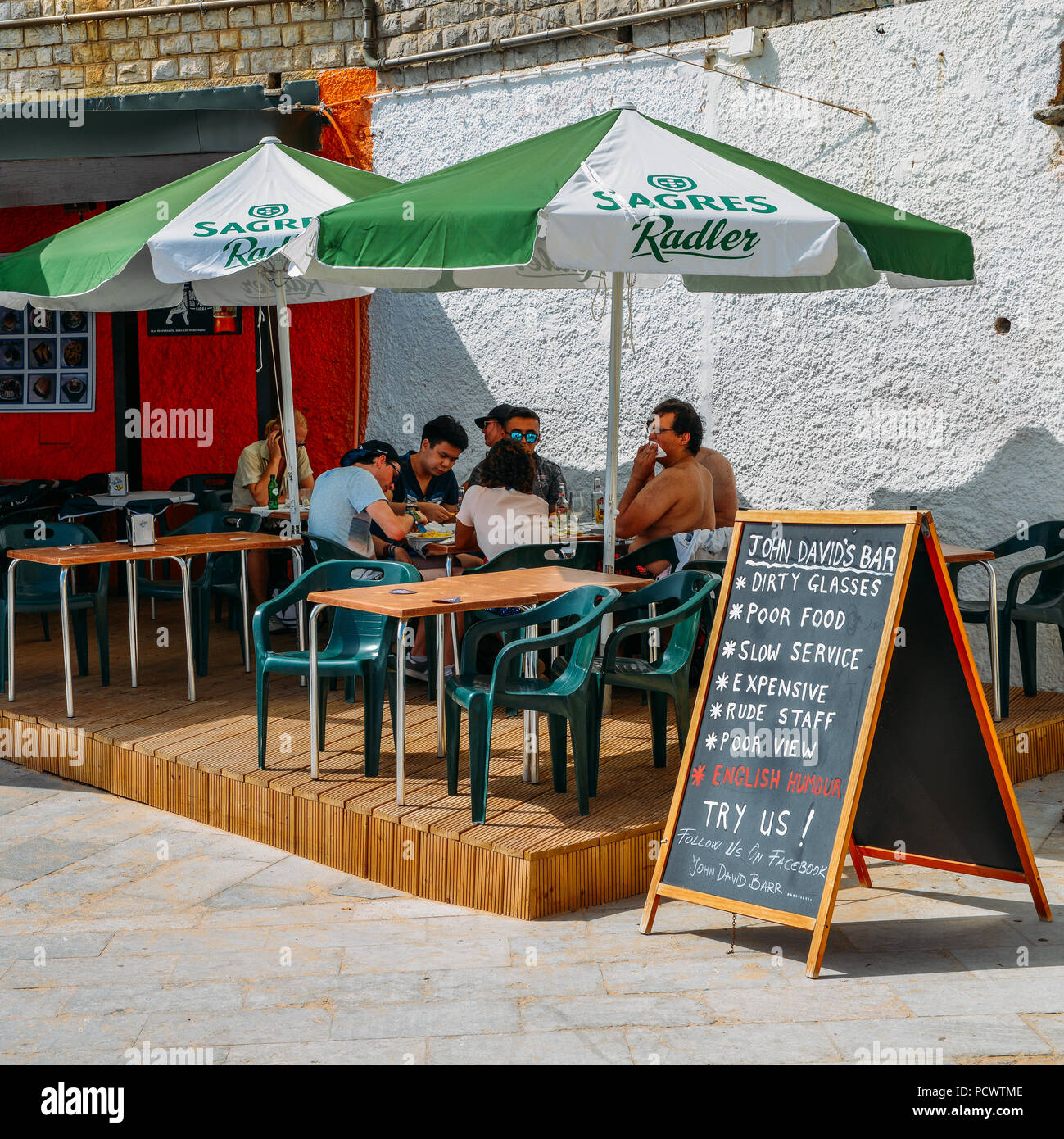 Sign with British humour at a pub in Cascais, Portugal - Stock Image