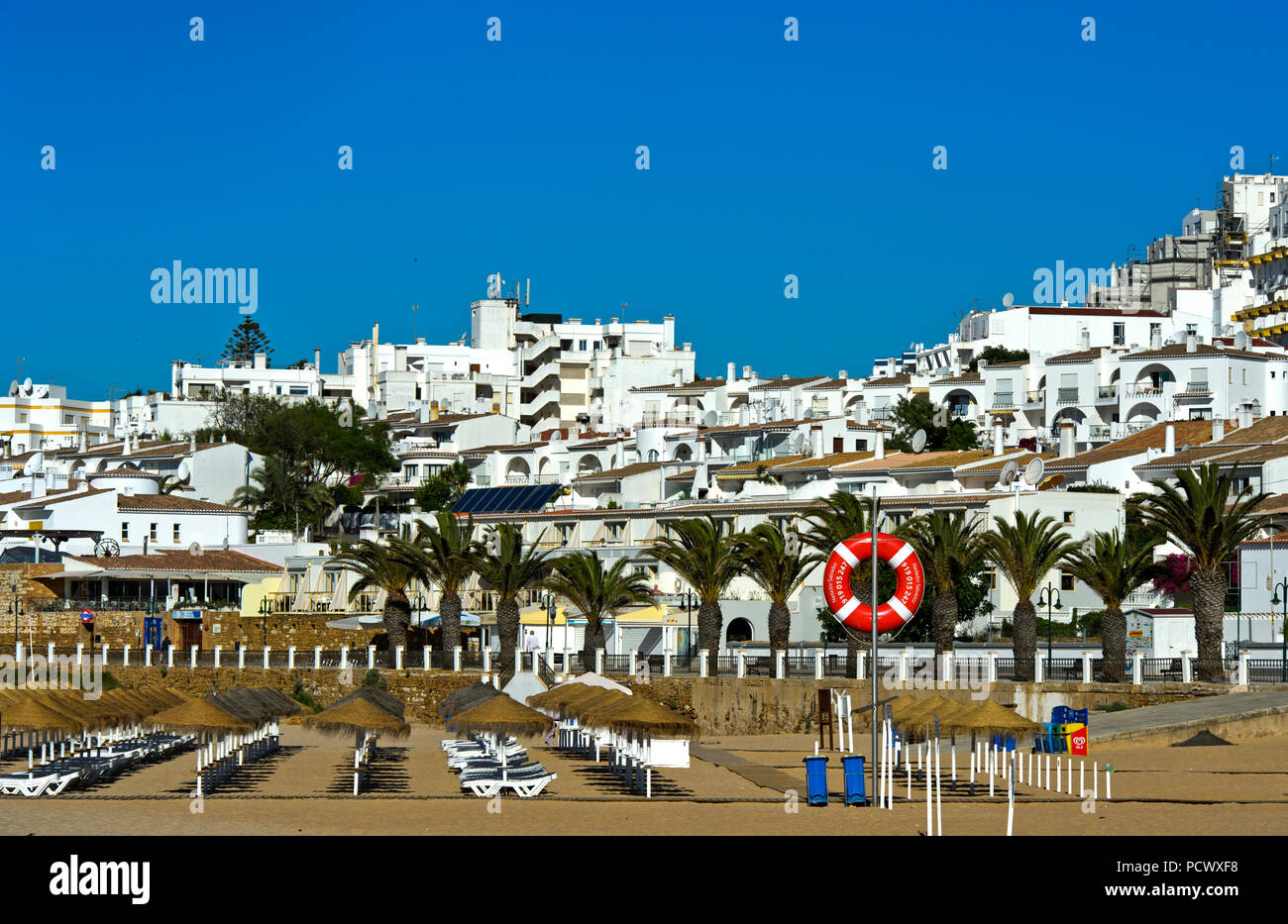 Holiday-villa complexes behind the beach, Praia da Luz, Luz, Algarve, Portugal - Stock Image