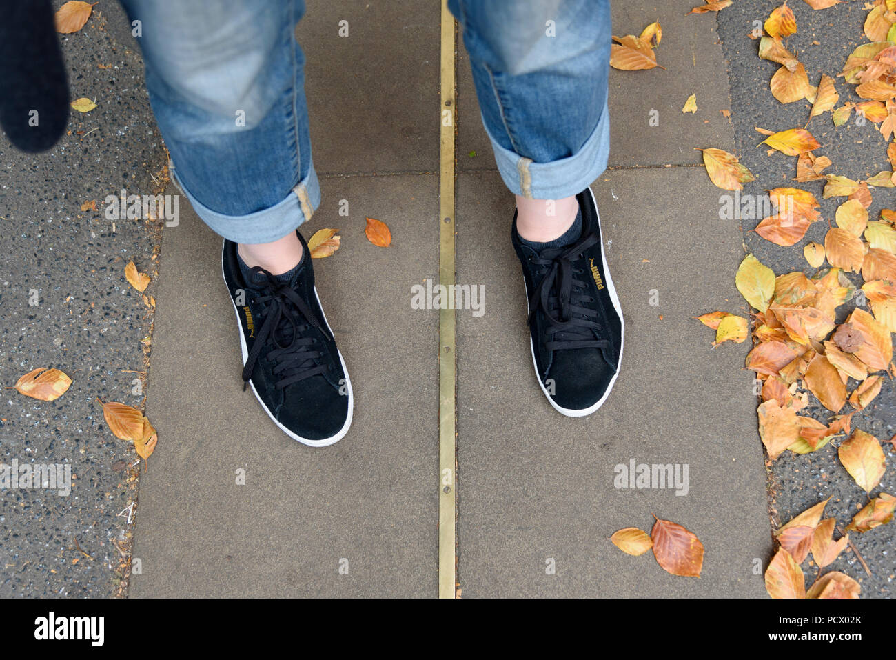 12-10-2017 London, UK. Feet either side of the Greenwich Meridian Line.  Photo: © Simon Grosset - Stock Image