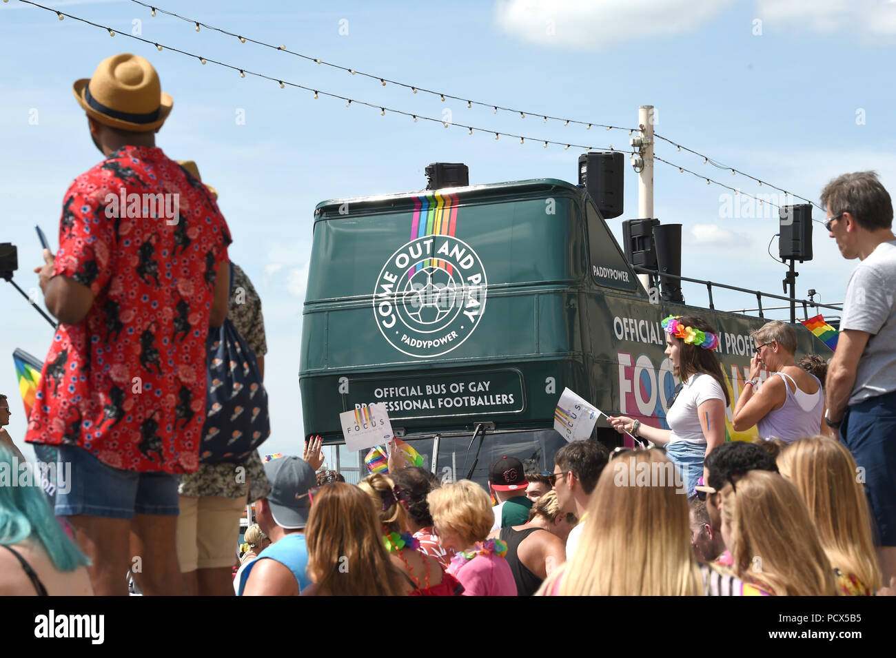 Brighton UK 4th August 2018 - The controversial Paddy Power bus with its message for professional footballers to come out joins the Brighton Pride Parade held over this weekend in beautiful hot sunny weather . The annual Brighton Pride event attracts thousands of visitors from all over the world with Britney Spears set to perform later tonight Credit: Simon Dack/Alamy Live News - Stock Image