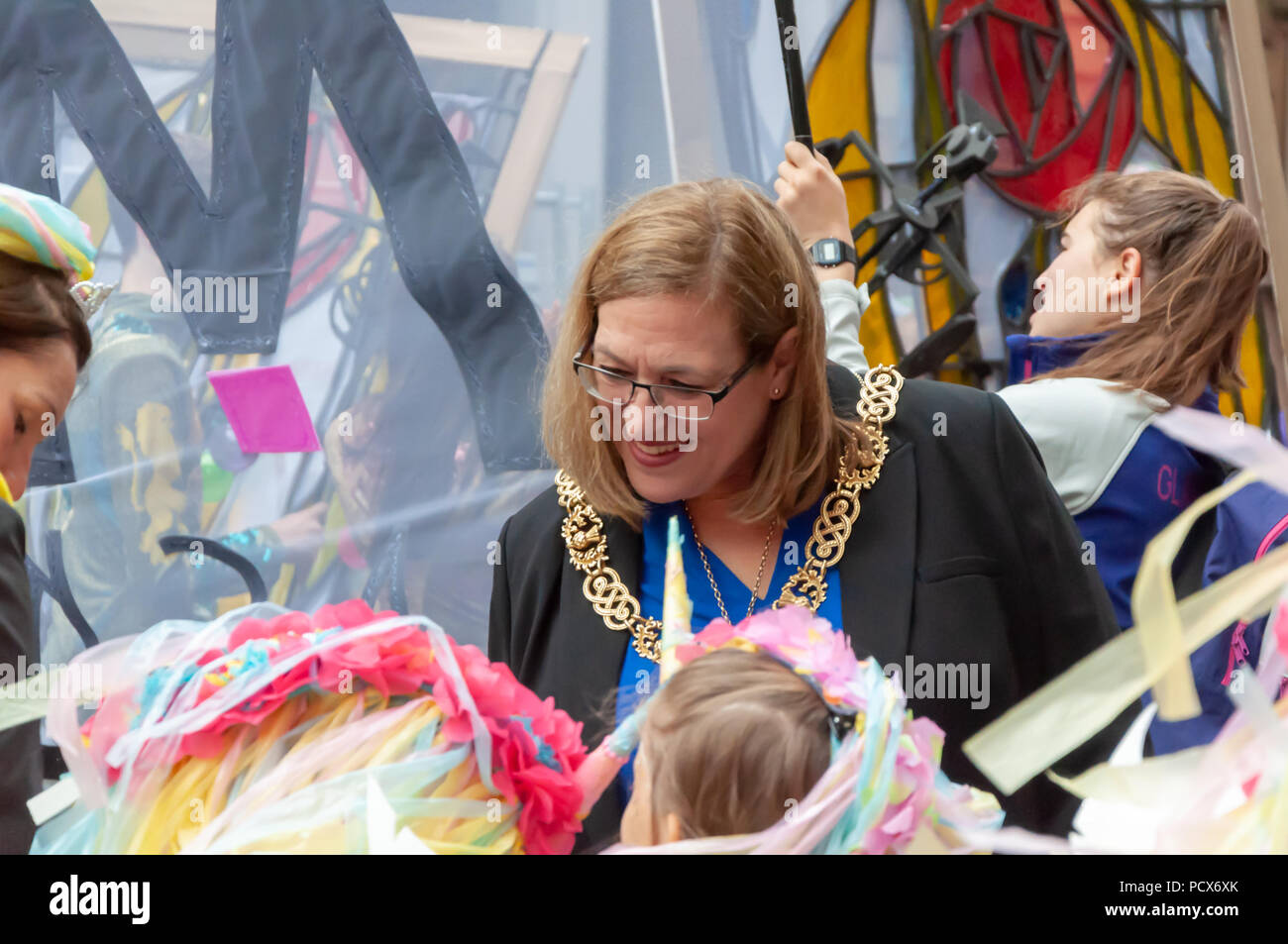 Glasgow, Scotland, UK. 4th August, 2018. The Lord Provost Of Glasgow Eva Bolander meets the performers of the Festival 2018 Carnival Procession before it travels through the streets of the city. Festival 2018 is the cultural programme of the Glasgow 2018 European Championships. The carnival includes local and international  musicians, dancers and street performers. The procession started at George Square and travelled through South Frederick St, Ingram St, Hutcheson St, Wilson St, Bell St, High St, Saltmarket and finished at GO LIVE in Glasgow Green. Credit: Skully/Alamy Live News - Stock Image
