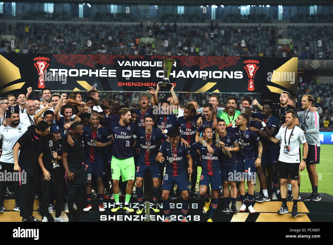 Shenzhen, China's Guangdong Province. 4th Aug, 2018. Team members of Paris Saint-Germain's celebrate with the trophy after winning the French Trophy of Champions football match between Monaco and Paris Saint-Germain at Universiade Stadium in Shenzhen, south China's Guangdong Province, on Aug. 4, 2018. Paris Saint-Germain won 4-0. Credit: Mao Siqian/Xinhua/Alamy Live News - Stock Image