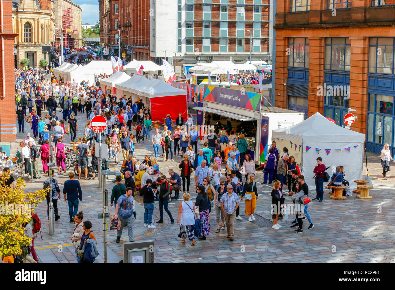 Glasgow, UK, 4 Aug 2018. On the first day of the Merchant city festival, thousands took advantage of the warm summer evening to enjoy the street artists, musicians, dancers and food stalls. The festival, an annual event, is running at the same time as the European Games and is due to finish on 12 Augusttourists - Stock Image