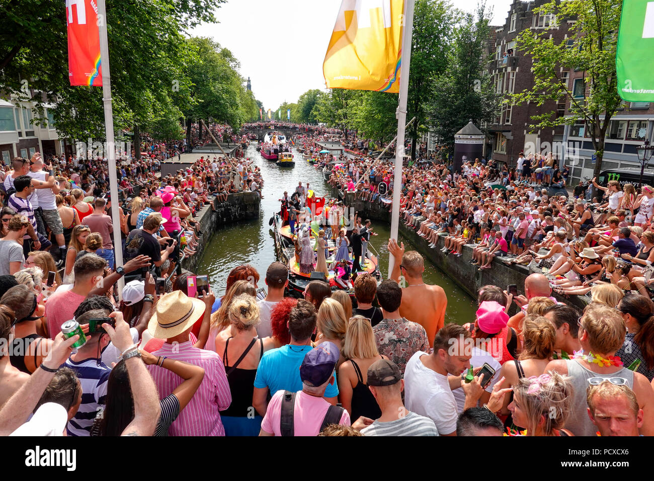 Amsterdam, Netherlands. August 4, 2018, Hundreds of thousands of visitors lined the canals for the annual Canal Pride. Credit: Wiskerke/Alamy Live News Stock Photo