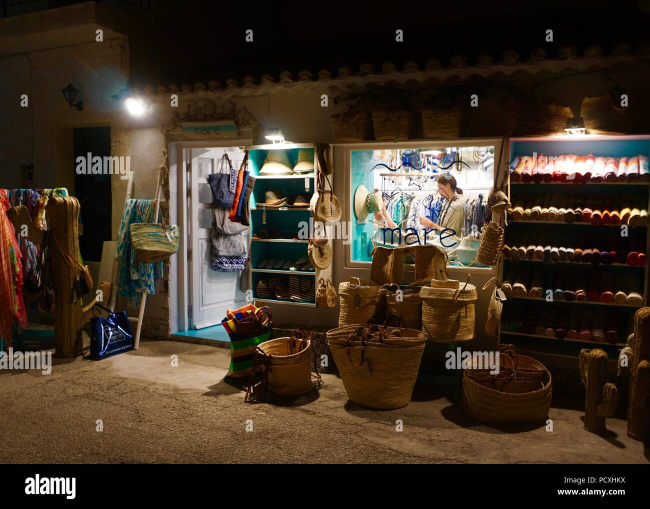 brightly lit gift shop in corfu greece at night stock photo