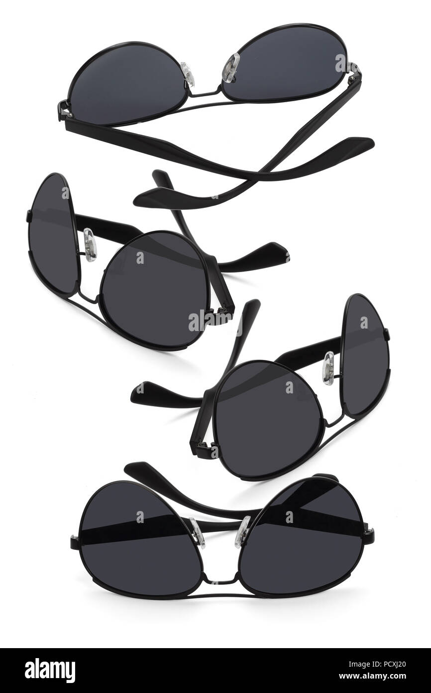 Collection of Plastic Sunglasses on White Background - Stock Image