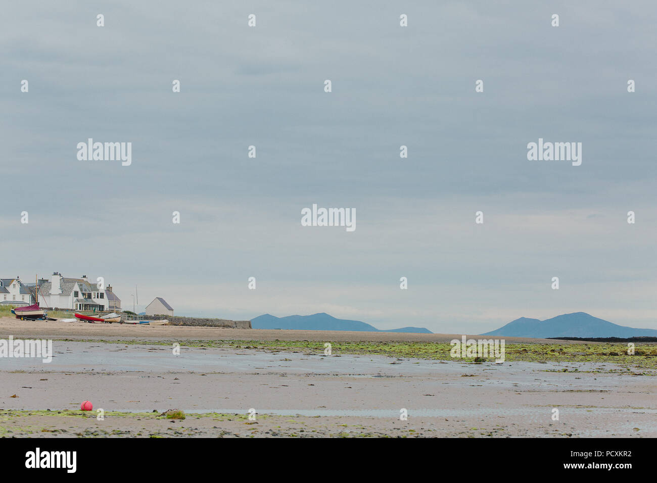 View across Traeth Cridyll (Rhosneigr family beach, Boating Beach), Anglesey, North Wales towards the Llyn Peninsula, - Stock Image