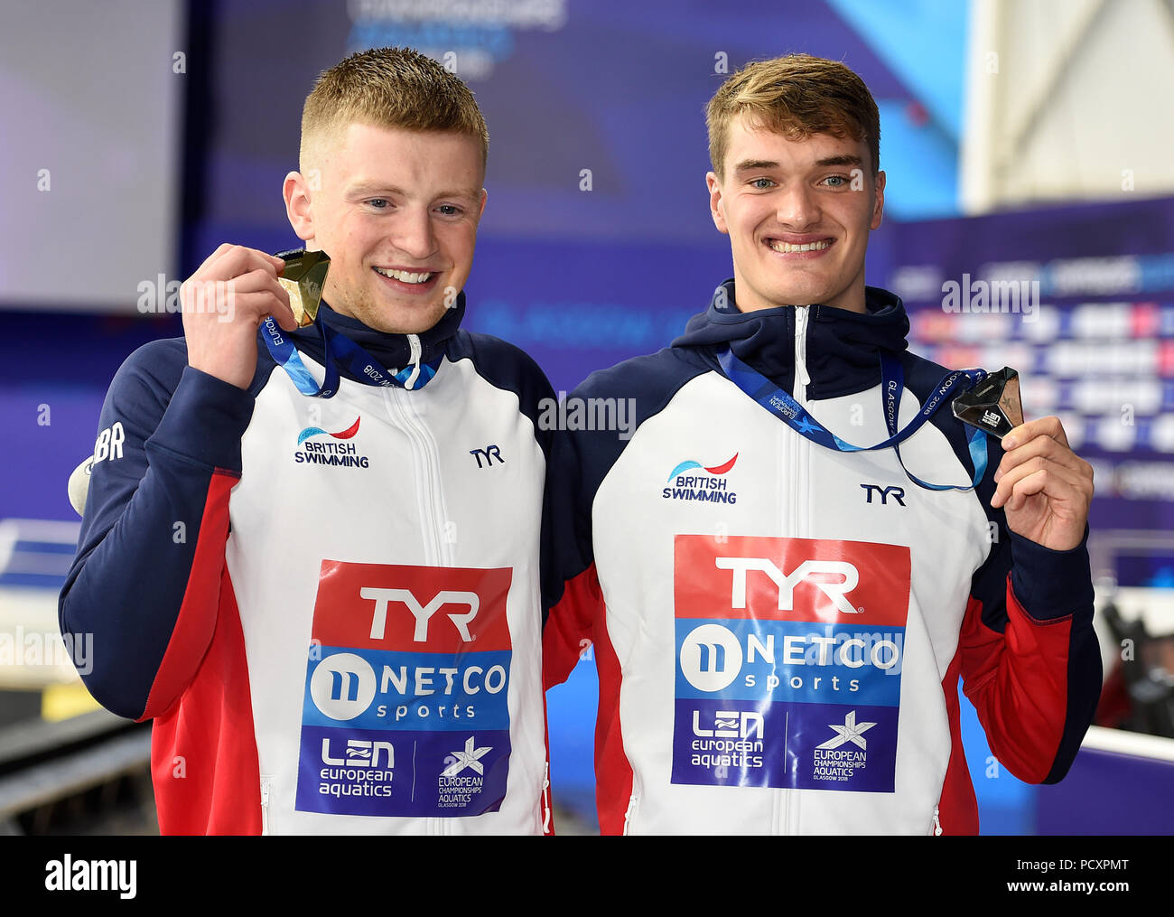 9a7468a031b Great Britain s Adam Peaty (left) with his gold medal alongside compariot  James Wilby who won silver after the Men s 100m Breaststroke Final during  day ...