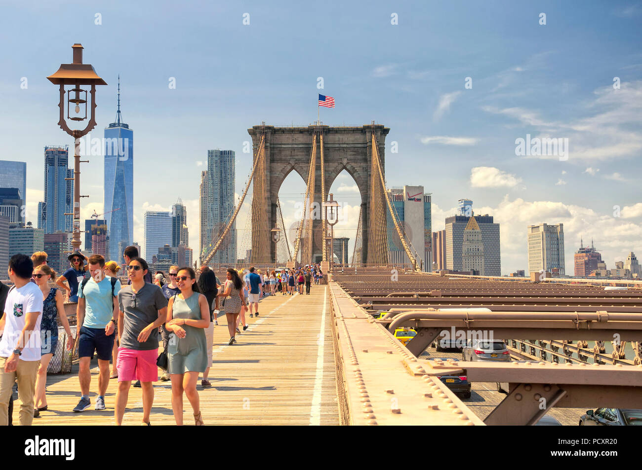 June 10, 2017.  New York City, New York.  Tourists and Traffic on the brooklyn bridge and the new york city skyline on a sunny day in the summertime. - Stock Image