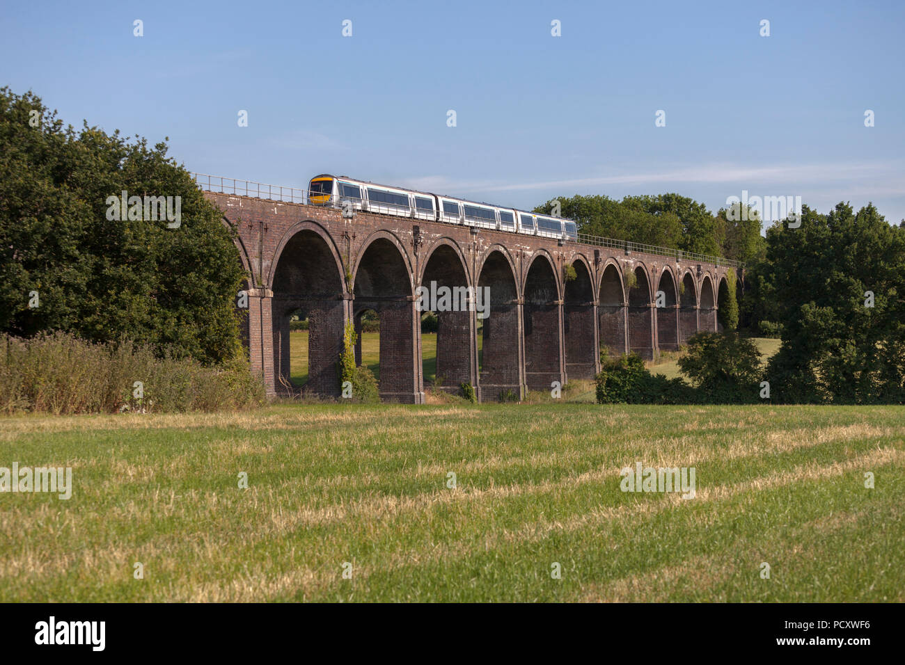 A Chiltern railways class 168 turbostar train crosses  Saunderton Viaduct (south of Banbury)	 with an express service for Marylebone Stock Photo