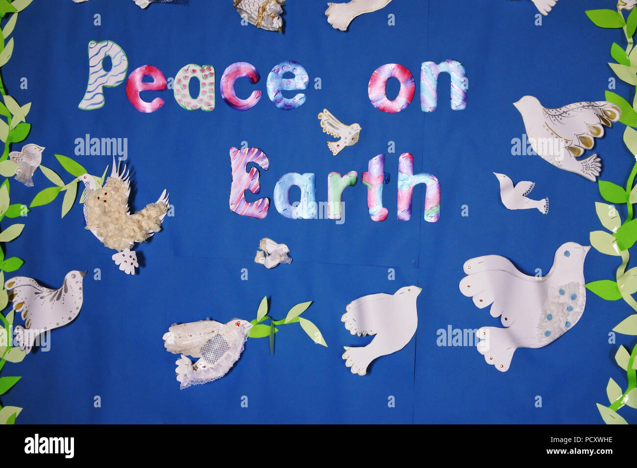 Peace on Earth posting made out of paper cut outs - John Gollop - Stock Image