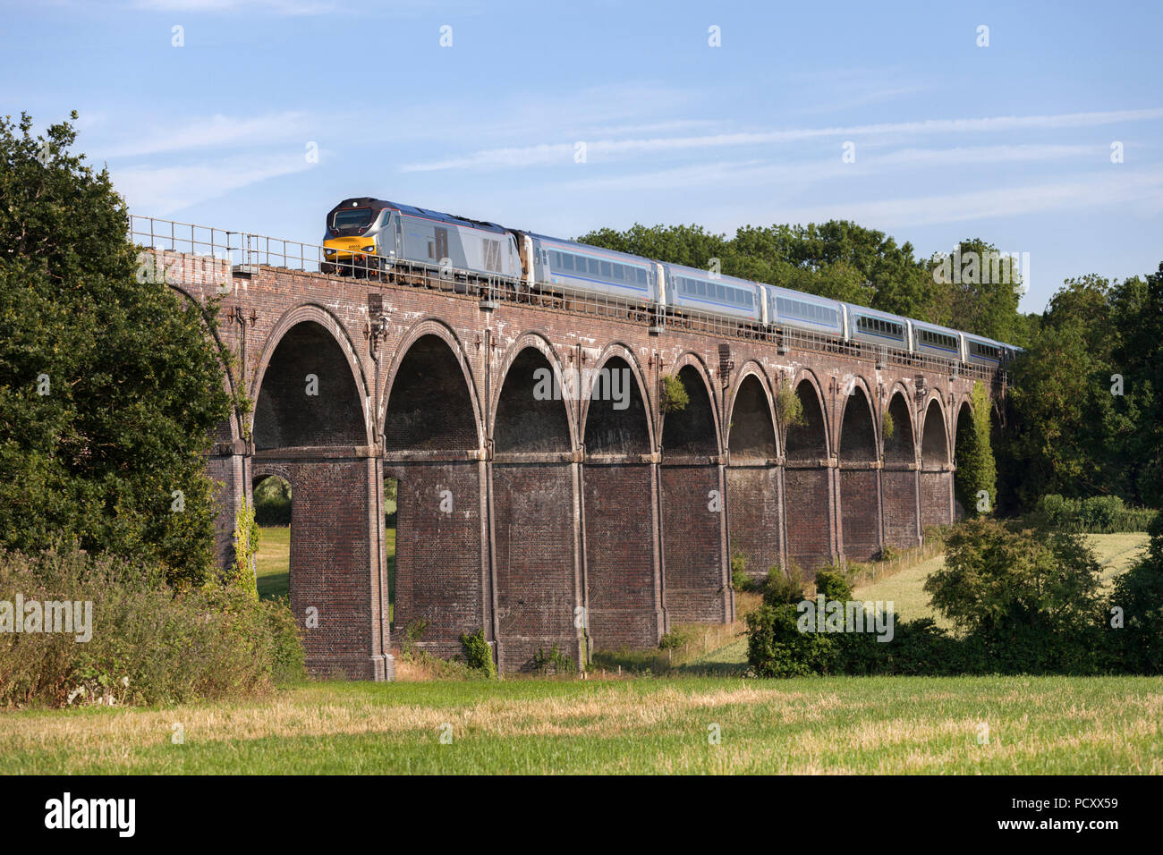 A Chiltern railways class 68 locomotive crosses  Saunderton Viaduct (south of Banbury) with a Chiltern railways mainline express train - Stock Image