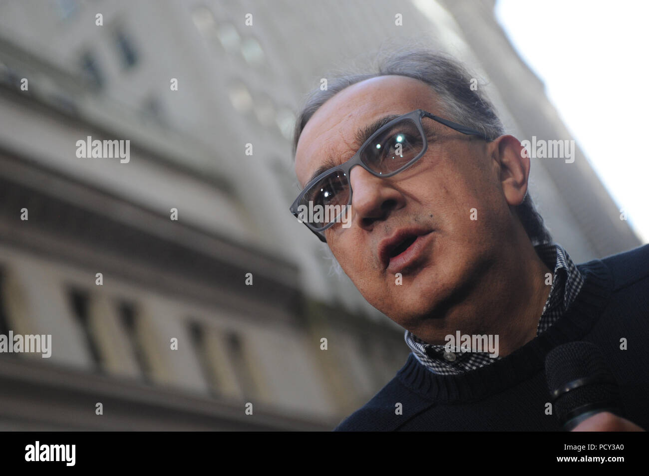 NEW YORK, NY - OCTOBER 21: Chief Executive Officer of Fiat Chrysler Automobiles Group Sergio Marchionne applauds after ringing the opening bell at the New York Stock Exchange (NYSE) as Ferrari starts trading for the first day in New York on Oct. 21, 2015. Ferrari's roaring debut on Wall Street Êalso Ferrari CEO Amedeo Felisa at the NYSE ahead of the racecar makerÕs stock market debut  on October 21, 2015 in New York City.  People:  Guests Stock Photo