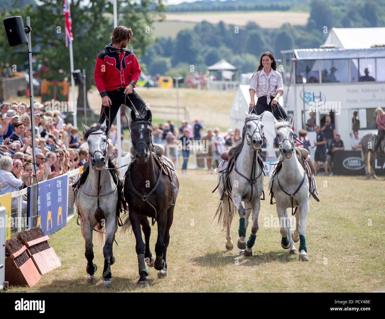 Members of the Devil's Horsemen perform in the main arena at the Festival of British Eventing at Gatcombe Park, Gloucestershire. - Stock Image
