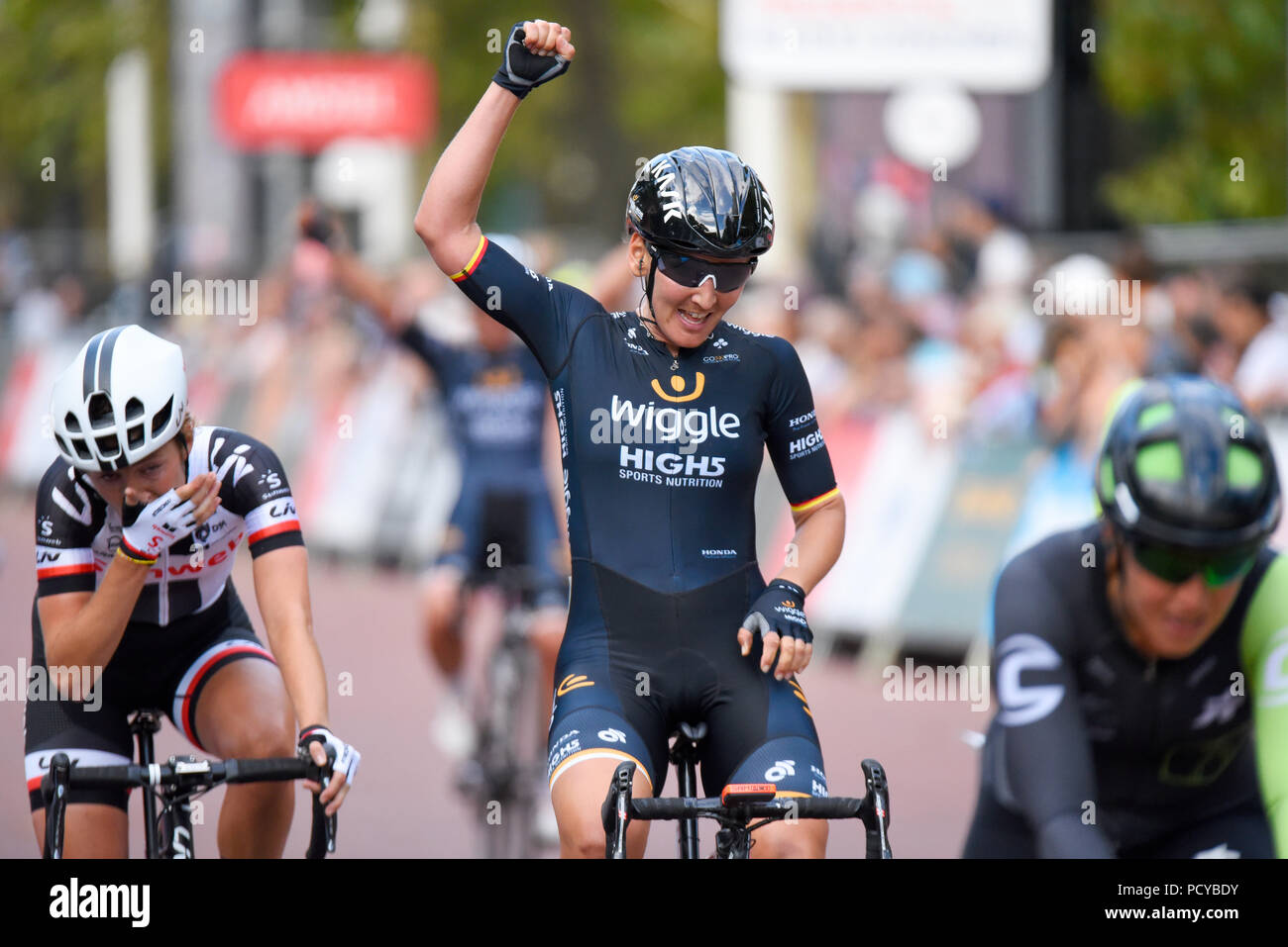 Wiggle High5 team female cyclist Lisa Brennauer at the Prudential RideLondon Classique women's cycle race celebrating team victory. The Mall, London Stock Photo