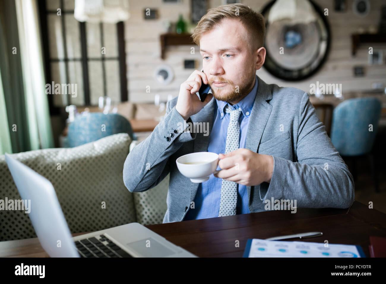Freelancer working at cafe - Stock Image
