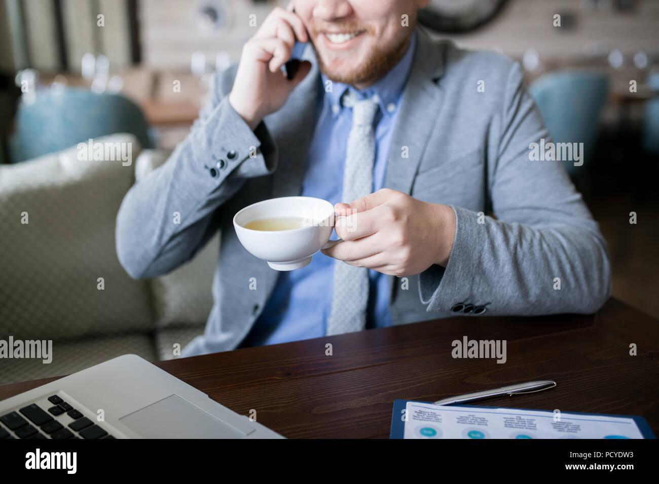Man drinking tea during work - Stock Image