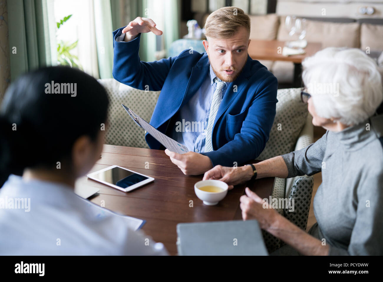 Business meeting at cafe - Stock Image