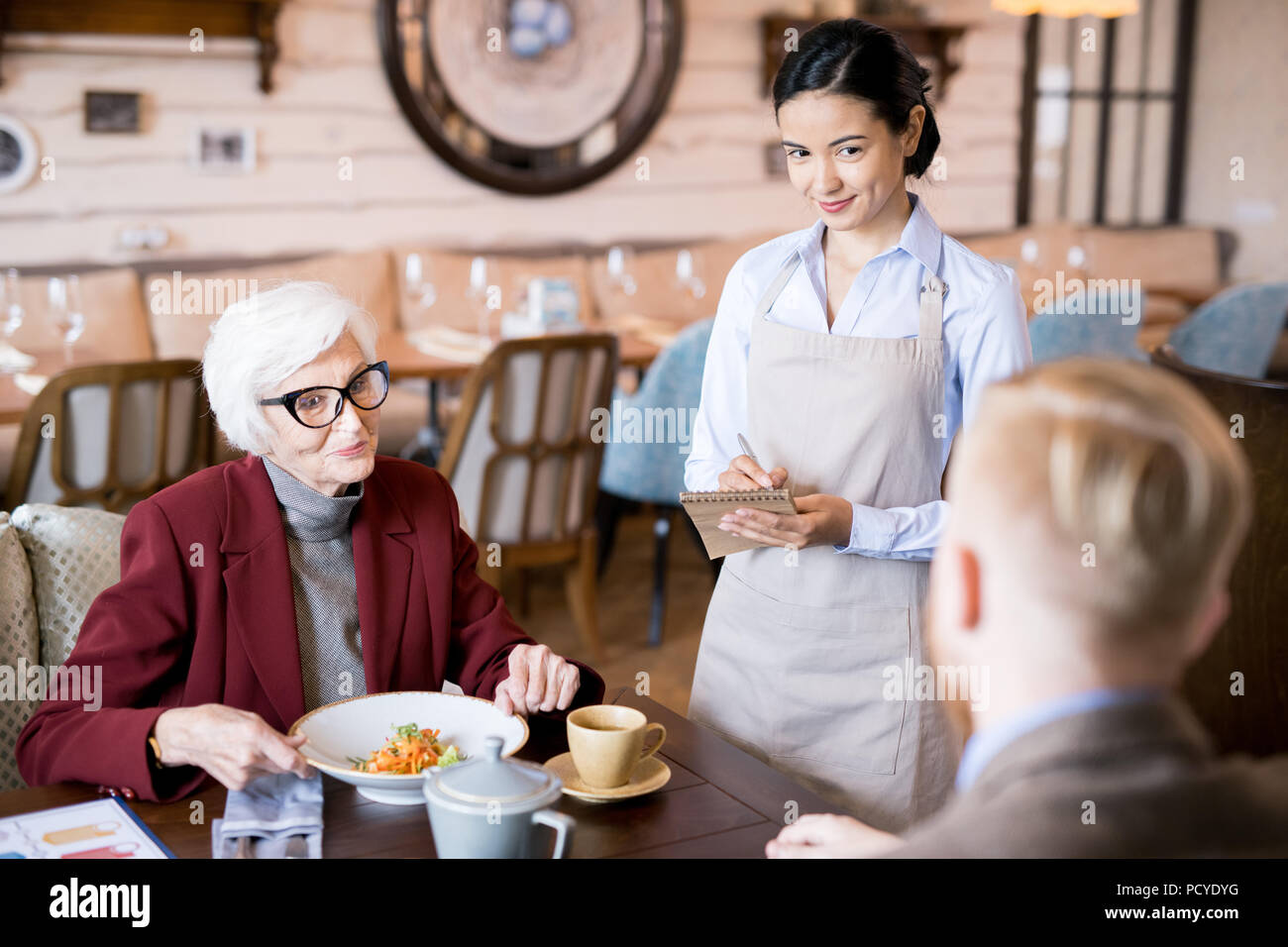 Family at the restaurant - Stock Image