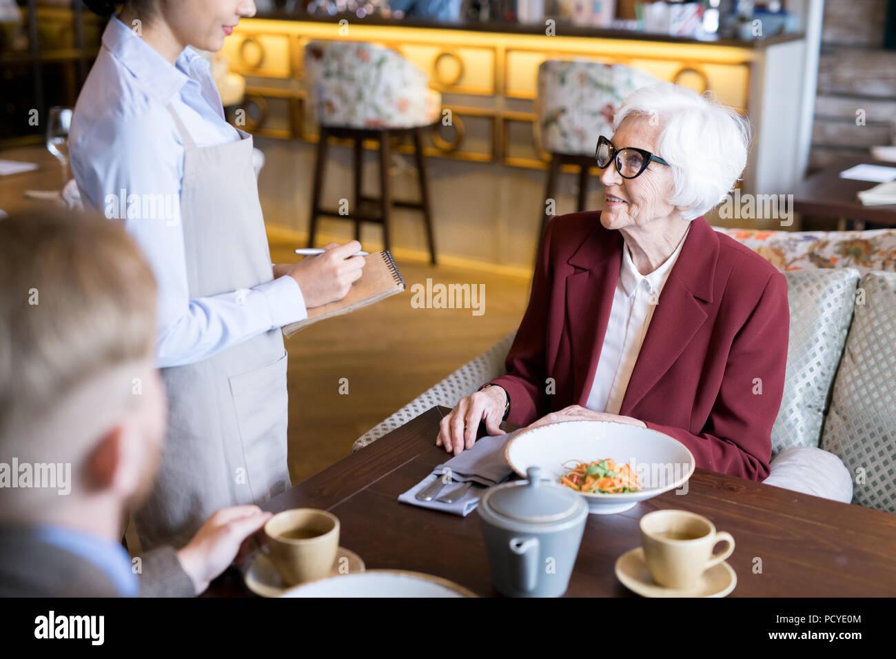Having dinner at the restaurant - Stock Image