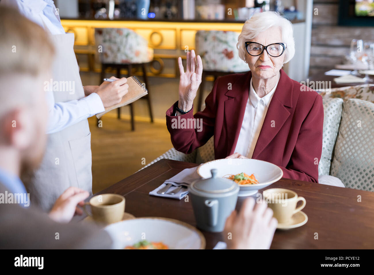 Family dinner at cafe - Stock Image