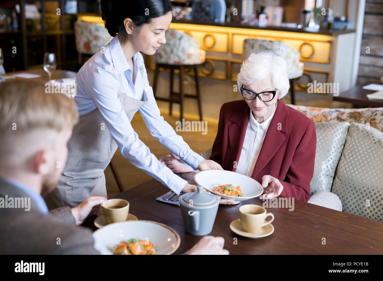 Having lunch at cafe - Stock Image