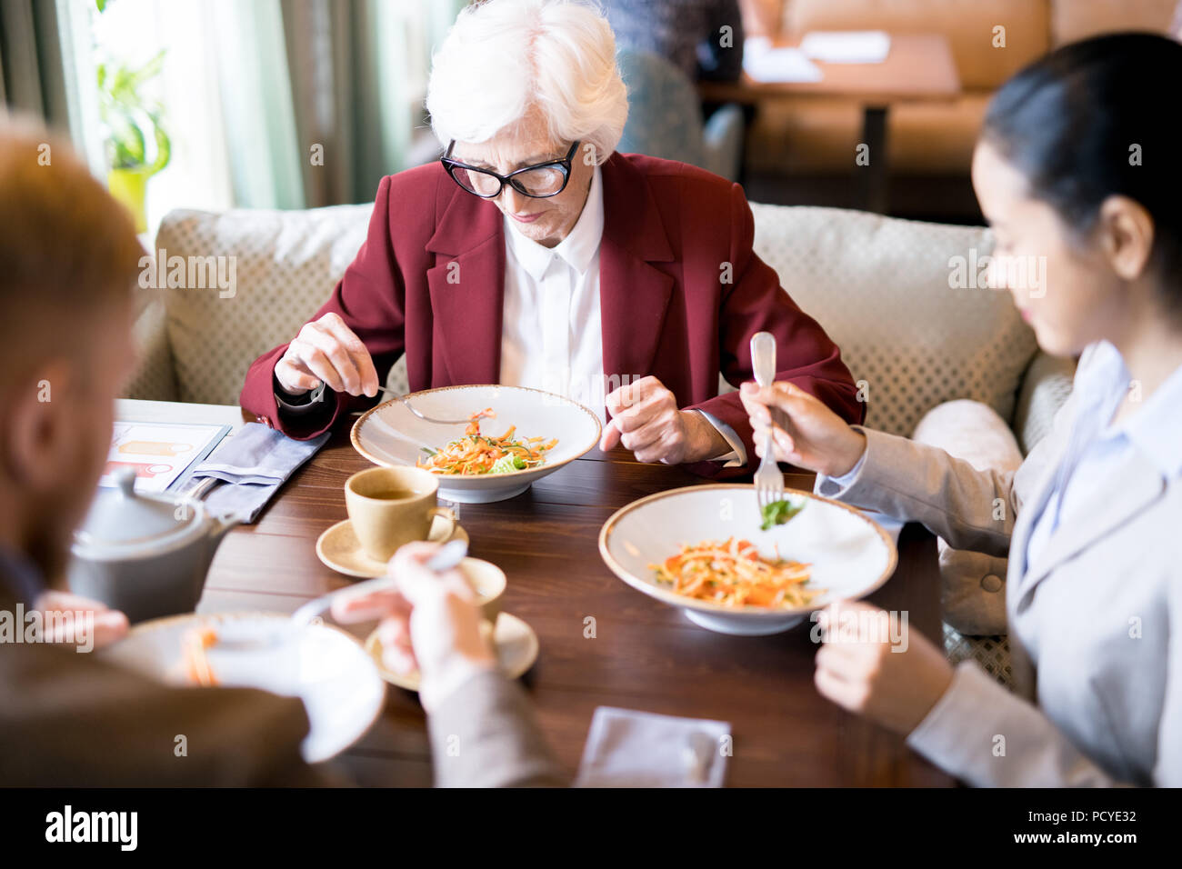 People at business lunch - Stock Image
