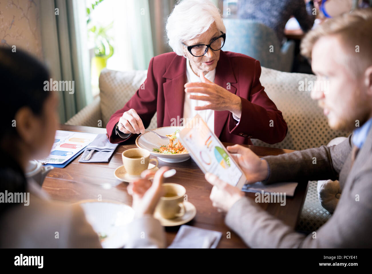 Business people at meeting - Stock Image