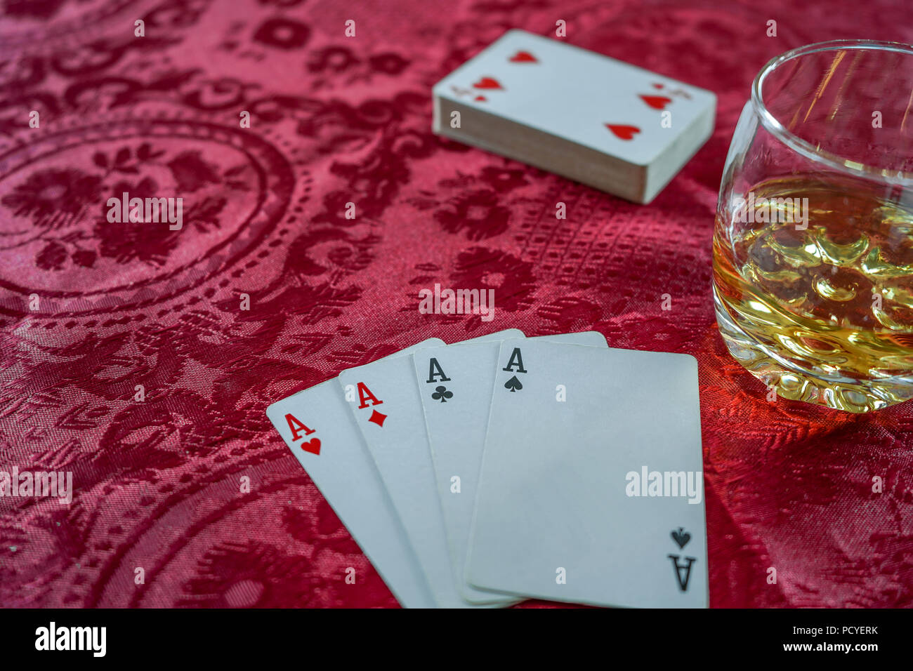 A playing card is a piece of specially prepared heavy paper, thin cardboard, plastic-coated paper, cotton-paper blend, or thin plastic, marked with di - Stock Image