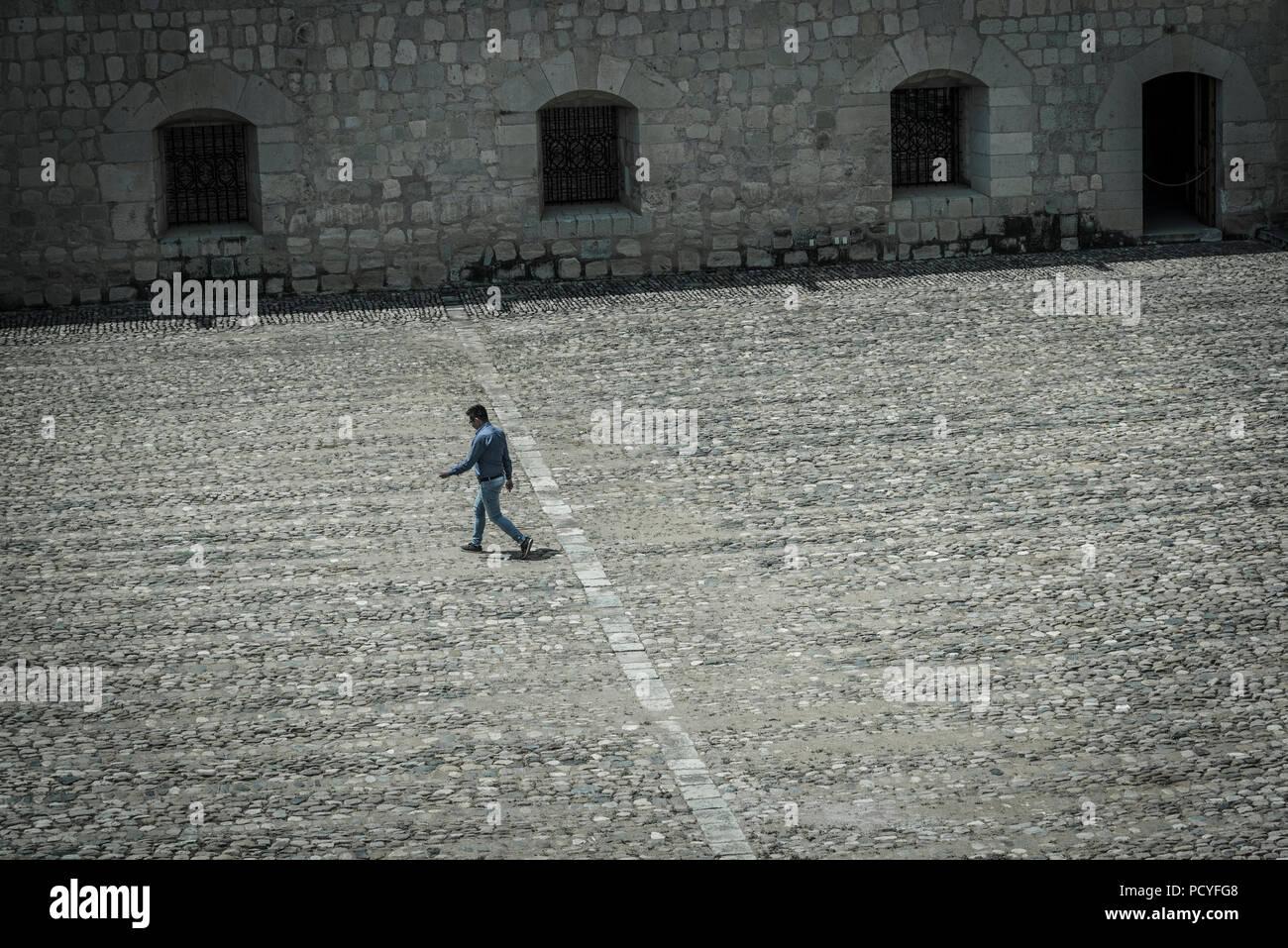 Santo Domingo de Guzman convent, Mexico Man walking across a cloister, Oaxaca, Mexico - Stock Image