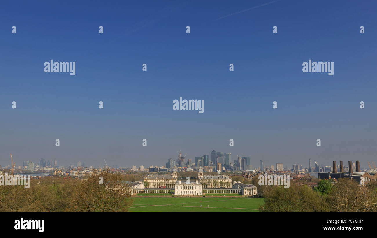 The view of the Old Royal Naval College in Greenwich, with the Docklands beyond, from the Royal Observatory on a clear spring morning - Stock Image