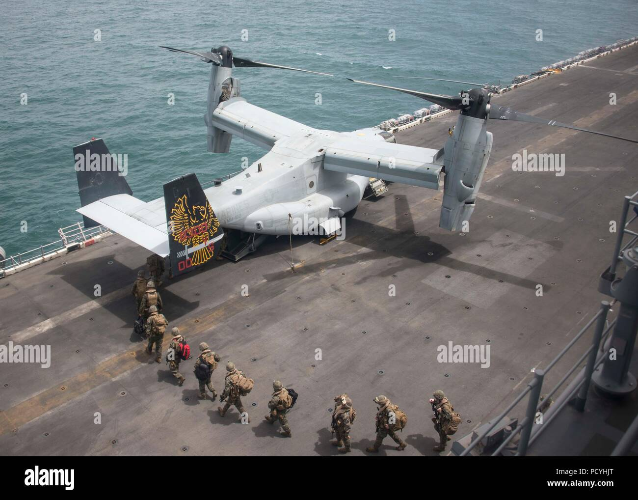 180803-N-ZG607-0047  ATLANTIC OCEAN (Aug. 3, 2018) Sailors and Marines load onto an MV-22B Osprey, attached to Marine Medium Tiltrotor Squadron (VMM) 162 (Reinforced) on the flight deck of the Wasp-class amphibious assault ship USS Iwo Jima (LHD 7), Aug. 3, 2018. Iwo Jima is deployed with its amphibious ready group in support of maritime security operations and theatre security cooperation efforts in Europe and the Middle East. (U.S. Navy photo by Mass Communication Specialist 3rd Class Dominick A. Cremeans/Released) Stock Photo