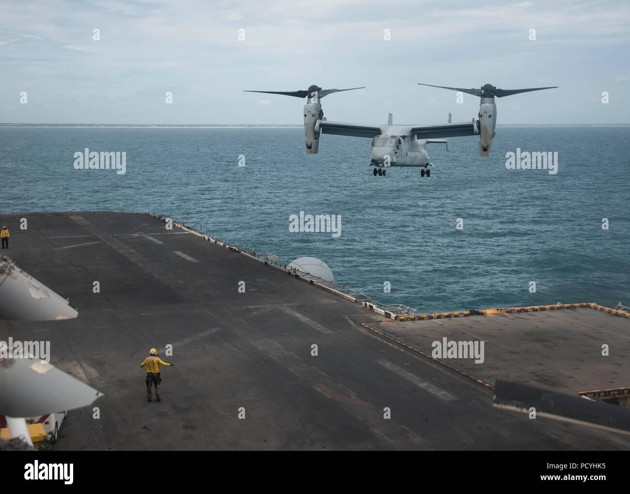 180803-N-ZG607-0023  ATLANTIC OCEAN (Aug. 3, 2018) An MV-22B Osprey, attached to Marine Medium Tiltrotor Squadron (VMM) 162 (Reinforced), prepares to land on the flight deck of the Wasp-class amphibious assault ship USS Iwo Jima (LHD 7), Aug. 3, 2018. Iwo Jima is deployed with its amphibious ready group in support of maritime security operations and theatre security cooperation efforts in Europe and the Middle East. (U.S. Navy photo by Mass Communication Specialist 3rd Class Dominick A. Cremeans/Released) Stock Photo