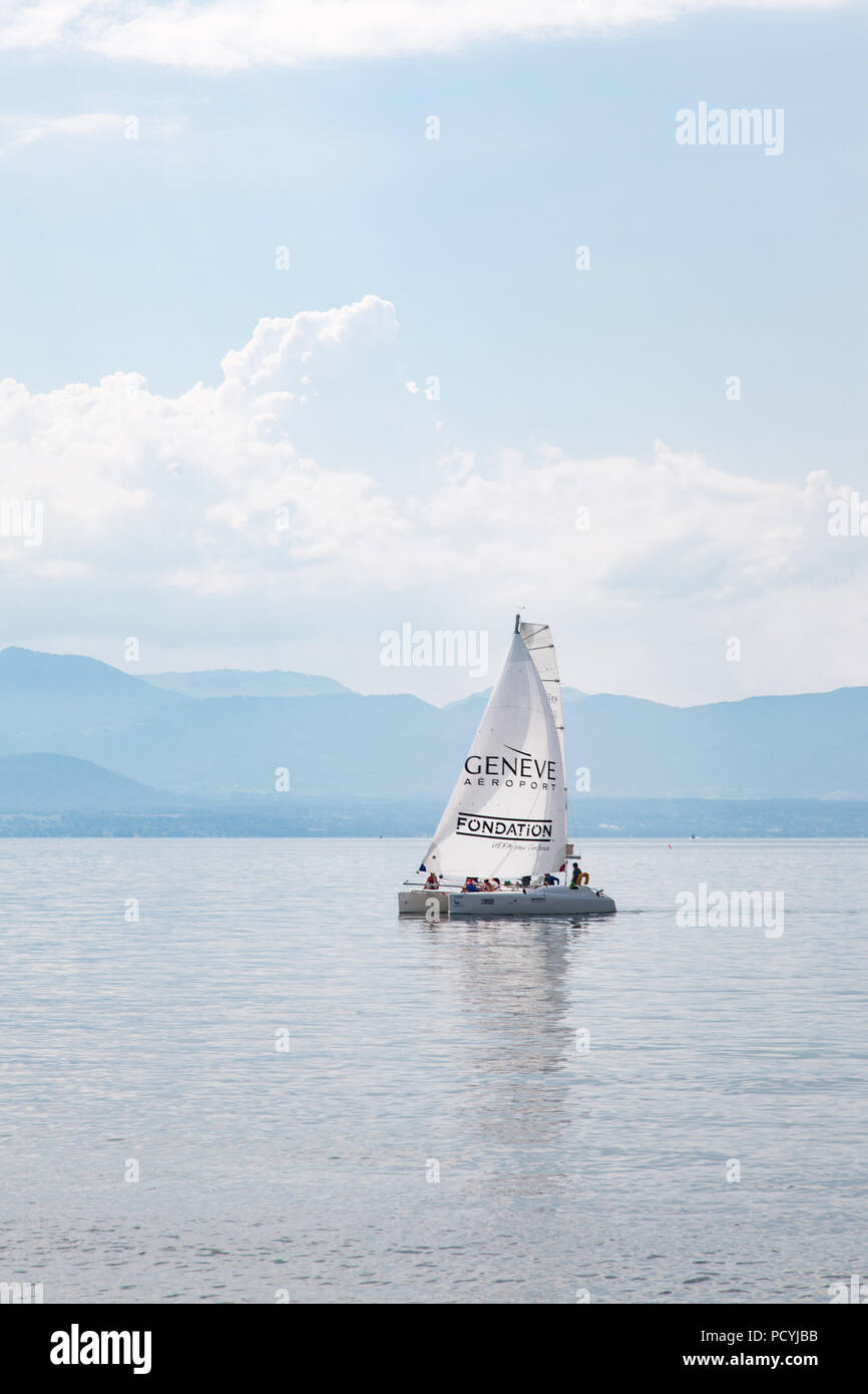 Catamaran yacht sailing on Geneva Lake (Lake Leman) near Rolle, La Cote region,  Vaud, Switzerland on beautiful sunny summer day - Stock Image