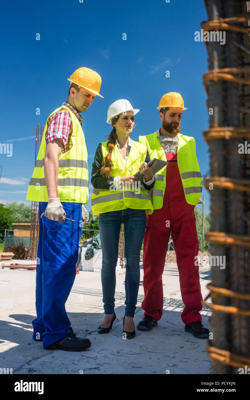 Architect supervising the work in progress on the construction - Stock Image