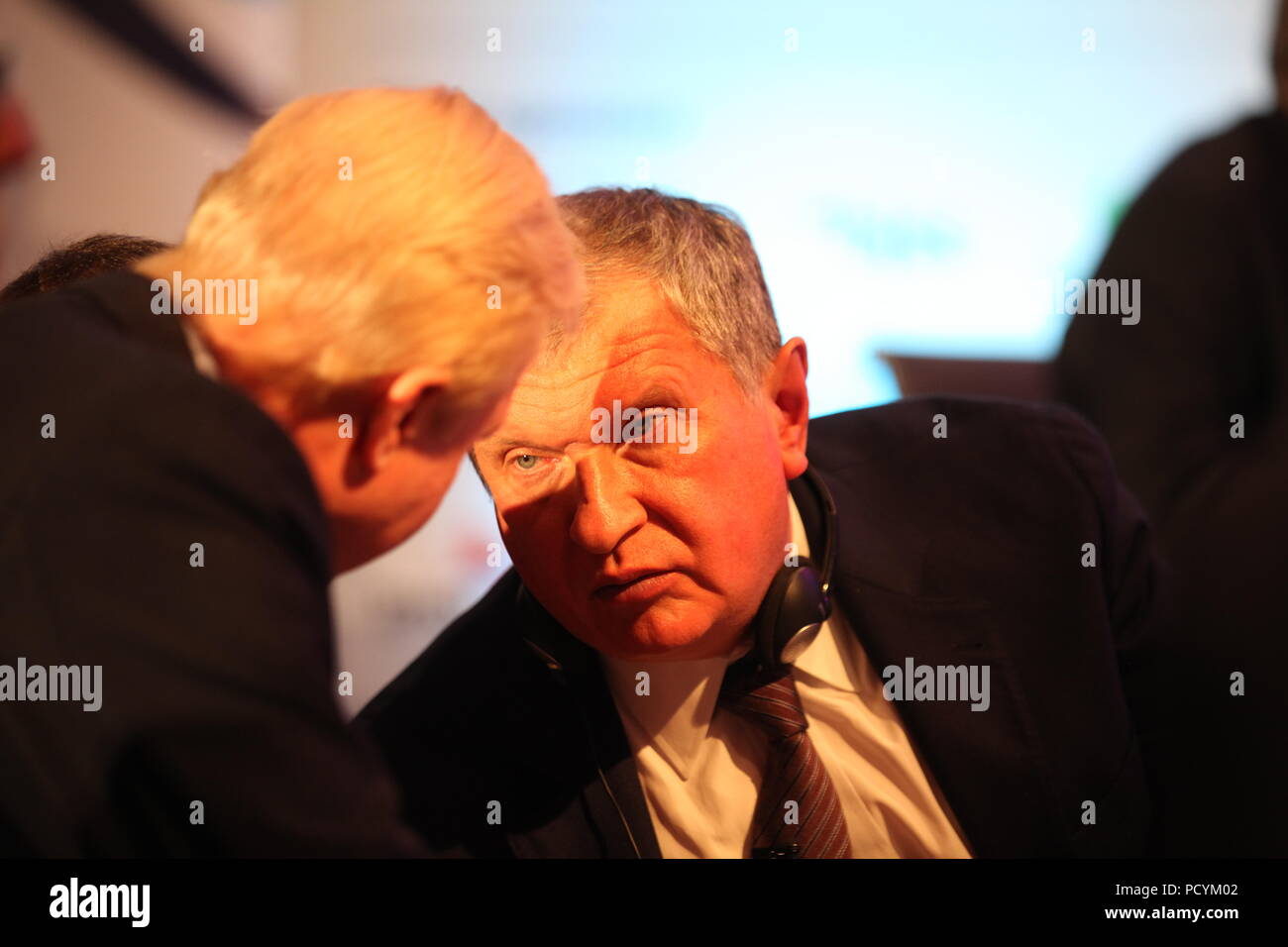 Russia's Oil and Gas Rosneft CEO Igor Sechin (R) talks to BP CEO Bob Dudley-  coffee-break at IP week  in London in Grosvenor House hotel at Park Lane - Stock Image
