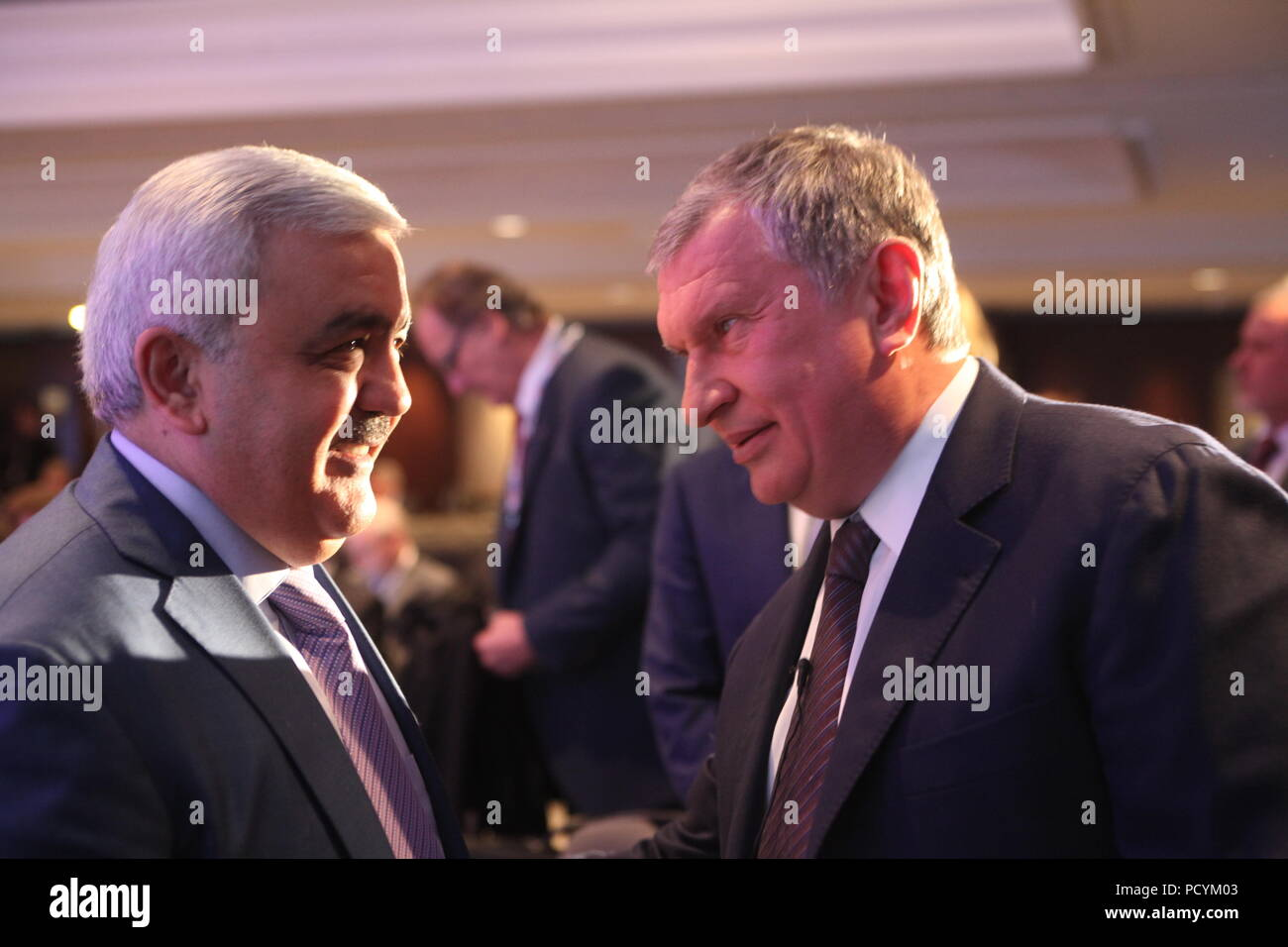 Azeri SOCAR CEO Rovnag Abdullayev (L) talks to Russia's oil and gas giant Rosneft boss Igor Sechin during coffee-break in IP week conference in London - Stock Image