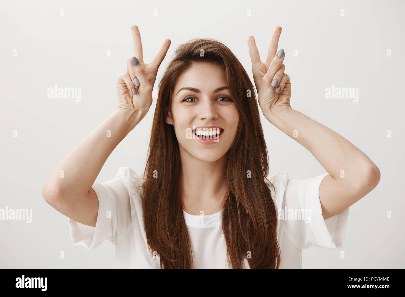 Attractive Girl Making Air Quotes Portrait Of Charming Young Female