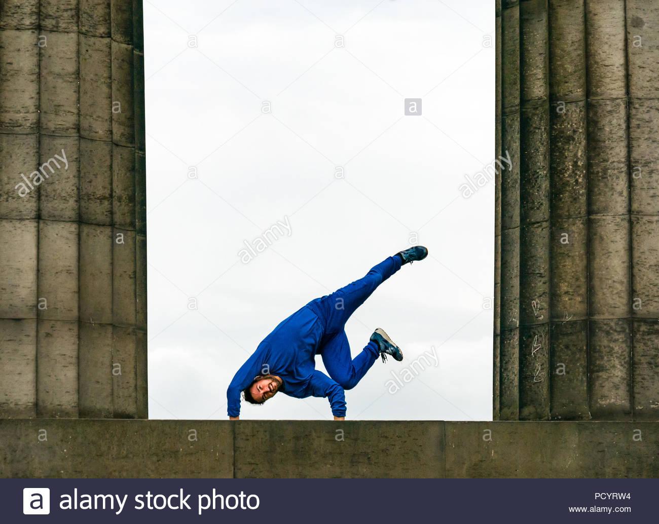 Barely Methodical Troupe (BMT) perform acrobatics on Calton Hill photocall during Fringe festIval at the National Monument, Edinburgh, Scotland, UK - Stock Image