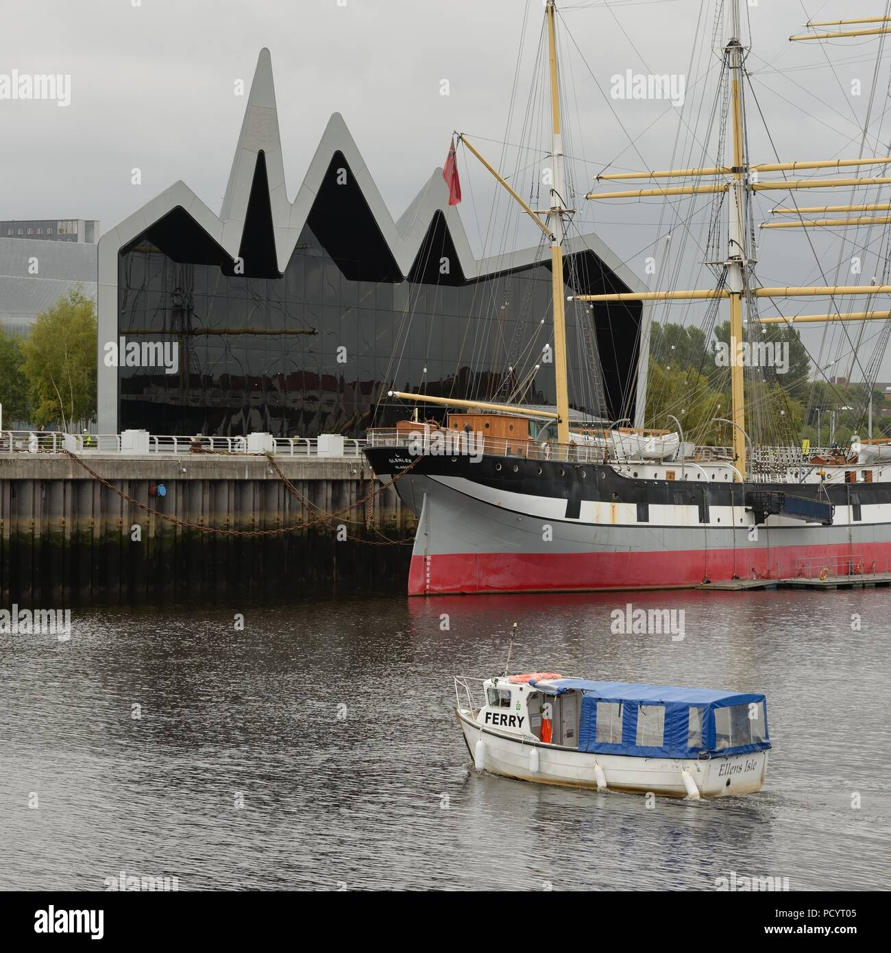 The free summer time ferry running across the Clyde between Govan and the Riverside museum of transport in Glasgow, Scotland, UK - Stock Image