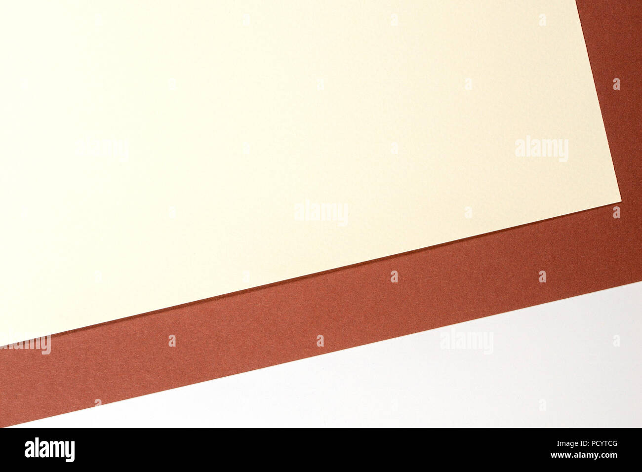 Color papers geometry composition background with white beige and brown tones - Stock Image
