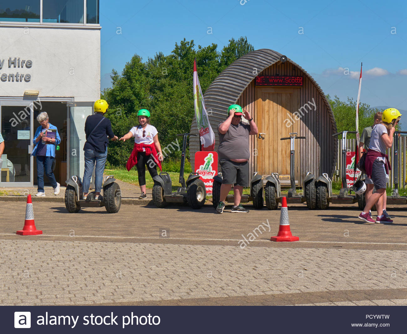 segway two-wheeled self balancing personal transporter invented by dean kamen in falkirk wheel hire centre in scotland uk - Stock Image