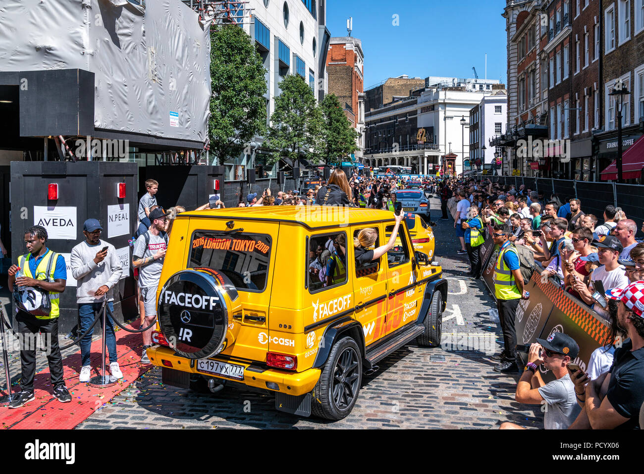 5 August 2018 - London, England. Russian team in yellow Mercedes AMG G63, 4x4 SUV before the Gumball Rally 3000 started in Covent Garden, London. - Stock Image