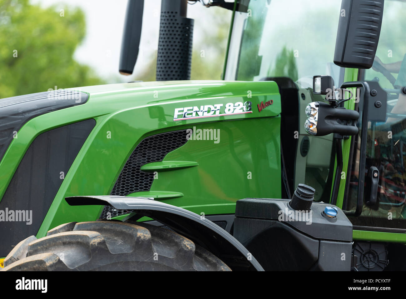 Closeup of the agricultural tractor FENDT 828 Vario on the fields - Stock Image