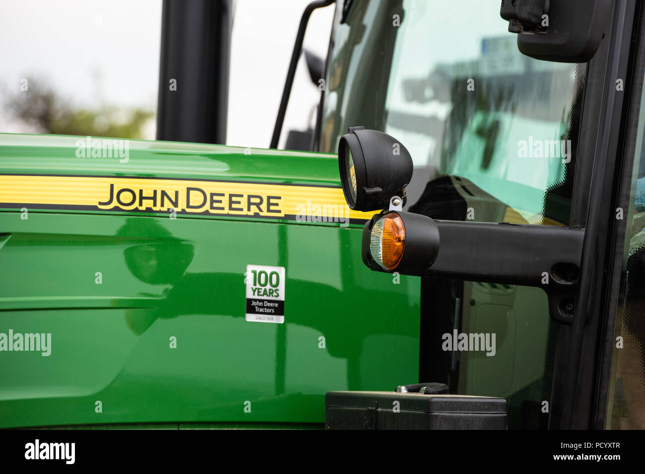 Closeup of an agricultural tractor by John Deere - Stock Image