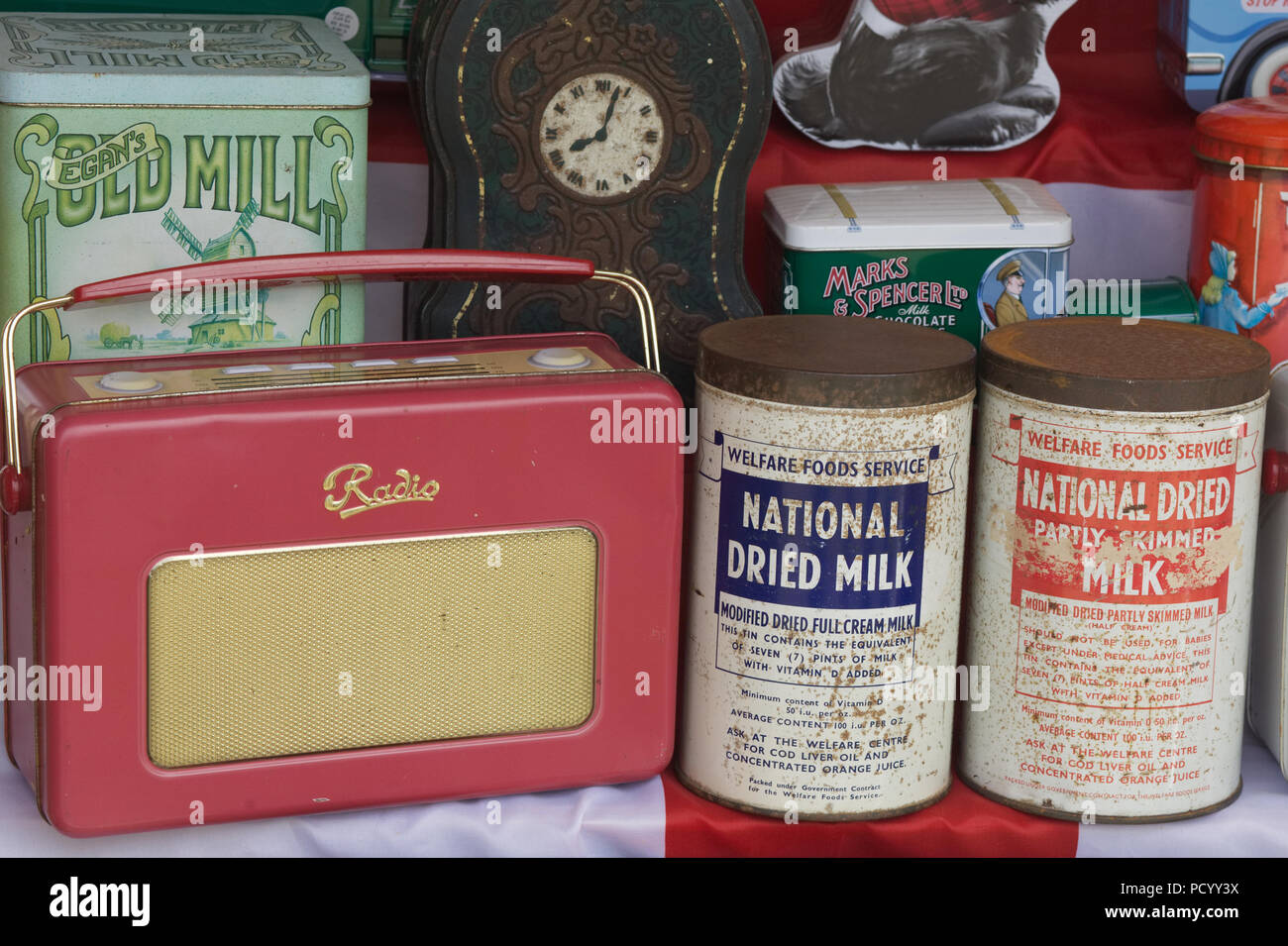 collection of dried milk tins and radios - Stock Image