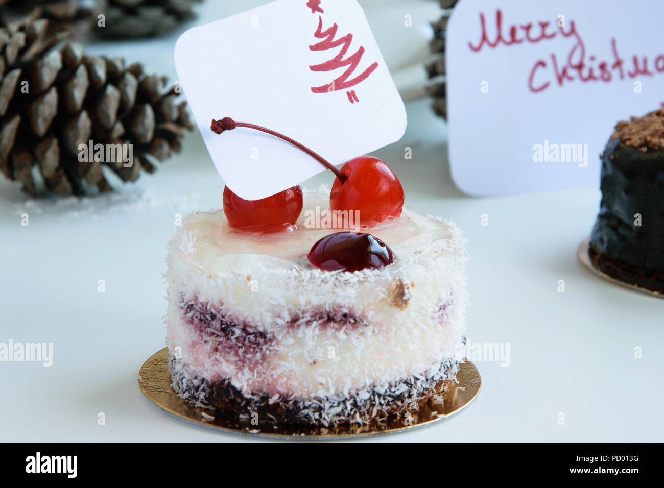 Winter Pastry Themes Delicious Cakes With Greeting Card On White